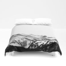 Mountain Views Duvet Cover    Cover yourself in creativity with our ultra soft microfiber duvet covers. Hand sewn and meticulously crafted, these lightweight duvet covers vividly feature your favorite designs with a soft white reverse side. A durable and hidden zipper offers simple assembly for easy care - machine washable with cold water on gentle cycle with mild detergent. Available for King, Queen, Full, Twin and Twin XL duvets - duvet insert not included.