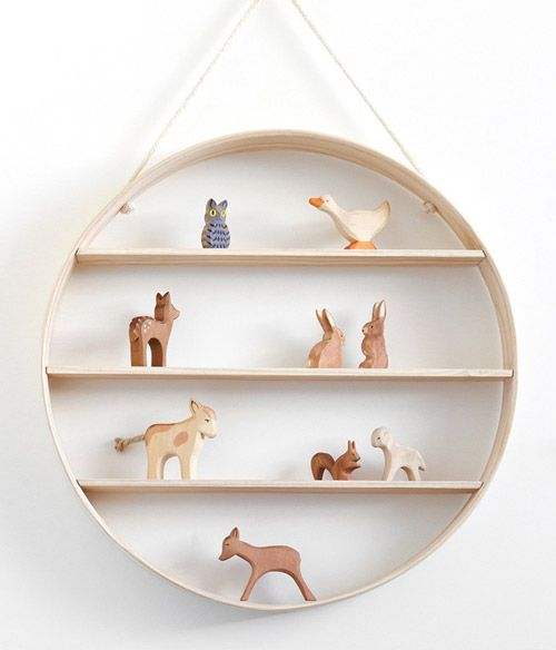 Lines meet a circle in this clever and lovely shelf construction.