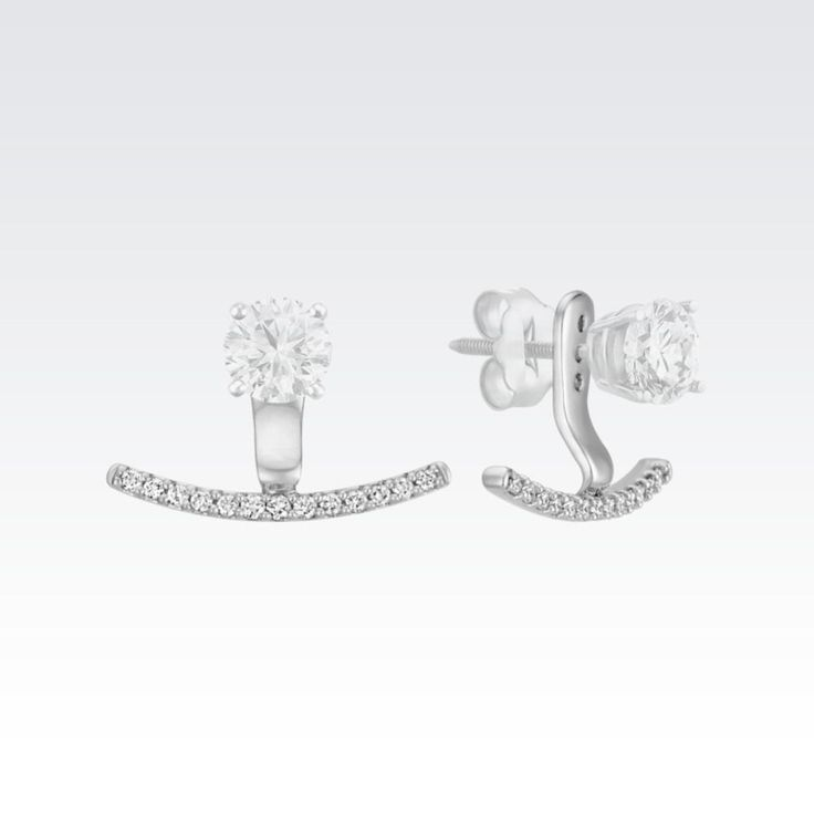 These on-trend horizontal bar earring jackets will beautifully accent your solitaire earrings of any size. Twenty-six round diamonds, at approximately .25 carat total weight, are set in quality 14 karat white gold in horizontal bar shapes. Simply place the post of your solitaire earrings through one of the three holes of the earring jackets and you have a great new pair of earrings. The diamond solitaire earrings pictured are not included. #earringjackets
