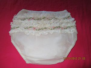 Ruffled rubber pants to wear over cloth diapers.  I had a couple for my dolls to wear.
