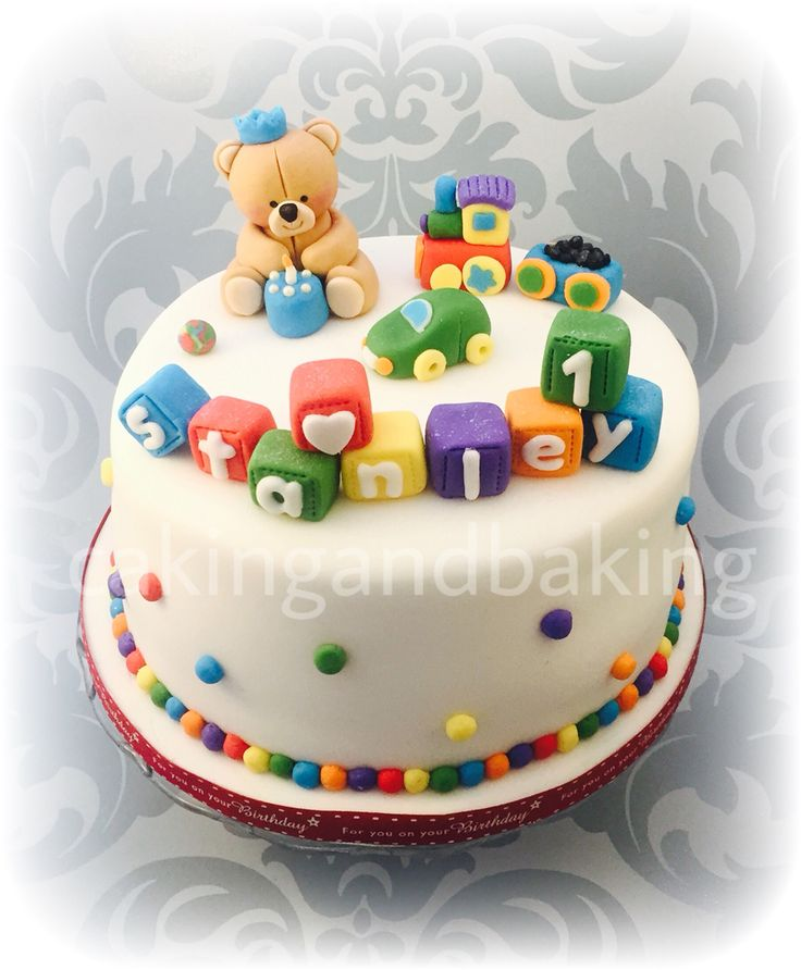 Happy 1st birthday Stanley ♥️a very cute forever friends inspired fondant teddy bear sits alongside a colourful fondant train, little fondant car and a collection of fondant blocks all rainbow colours for this adorable baby's 1st birthday cake