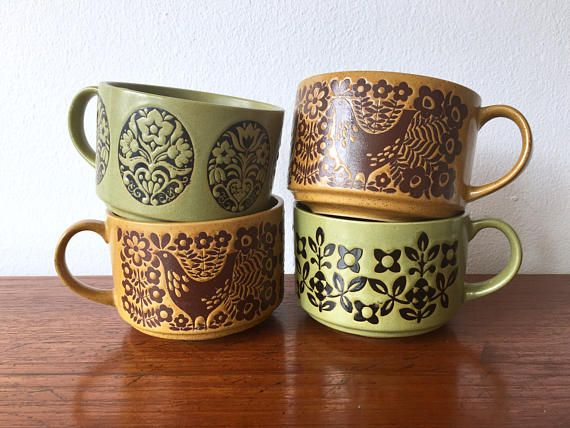 70s Vintage Stoneware Boho Set of 4 Mugs - 2 green mugs w differing floral designs - 2 orange brown mugs with identical bird (peacock) and flowers designs - large capacity mugs  Each Mug Measures: 4.45 diameter 5.75 wide with handle Shipping: May fit in large USPS flat rate box. CONDITION REFERENCE CHART RATING: Excellent Some marks on the brown mugs. Marks may be original and not flaws. No other signs of wear. Thanks for looking and check out my other listings at: https://www.etsy...