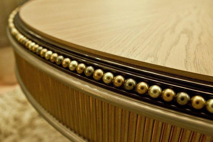 Three different shades of olive Swarovski pearls decorating the edge of the PERLAGE dining table by MARI IANIQ. #MARIIANIQ #luxury #bespoke #handmade #Olive #Swarvoski #pearls #PERLAGE #dining #table #interiors #design #decor
