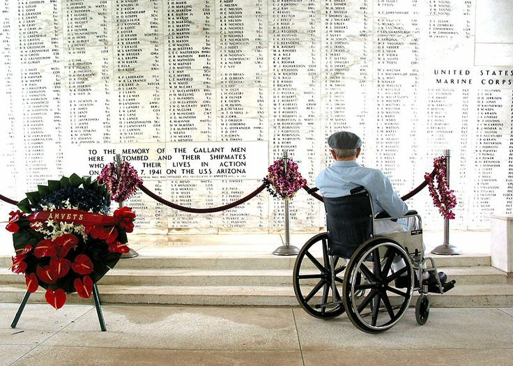 Pearl Harbor survivor Bill Johnson reads the list of names inscribed in the USS Arizona Memorial. The USS Arizona Memorial, located at Pearl Harbor, marks the resting place of 1.102 of the 1.177 sailors and Marines killed on the USS Arizona during the attack on Pearl Harbor on 7 December 1941 by Japanese imperial forces and commemorates the events of that day.