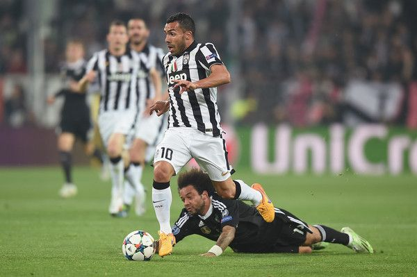 Marcelo Photos - Carlos Tevez of Juventus in action with Marcelo of Real Madrid during the UEFA Champions League semi final match between Juventus and Real Madrid at Juventus Arena on May 5, 2015 in Turin, Italy. - Marcelo Photos - 612 of 1918