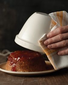 Steaming is the the traditional way to cook one of these English cakes. The batter and jam are put into a heatproof bowl, then topped with parchment and a tea towel.