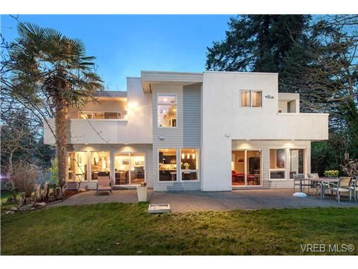 A very private, secluded & quiet haven under the canopy of a mature forest, this sophisticated, architecturally designed house offers a gregarious & very social layout on the main level w flow-through living & dining.