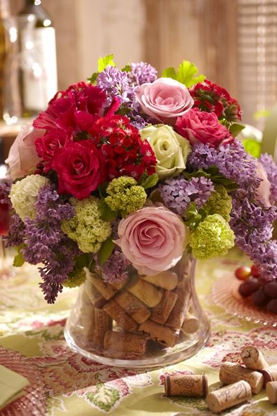 Wine Corks and Flowers...makes a beautiful centerpiece for a wine tasting party