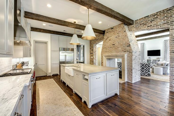 "3769 Garnet, Houston, TX: Photo Gorgeous kitchen with 48"" Wolf range and stainless steel Vent-A-Hood, Carrera white marble and concrete counters, great built-ins and huge walk-in pantry, dual sided Chicago brick fa"