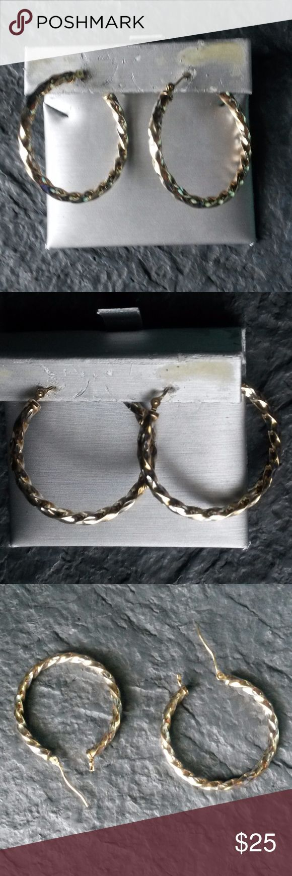 Silver and gold rope earrings Zales silver and gold rope earrings with a gold post. Diameter is a little bit bigger than a quarter.  No numbers or lettering that I can locate on them.EUC Zales Jewelry Earrings