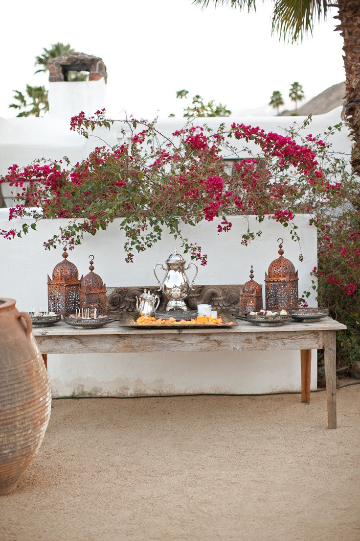 moroccan details - refreshment stand on bare wooden table