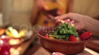 Closeup view of charming young female sitting at the table on tree house at the beach enjoying a lunch during summer's vacation at sea | Video | Colourbox on Colourbox