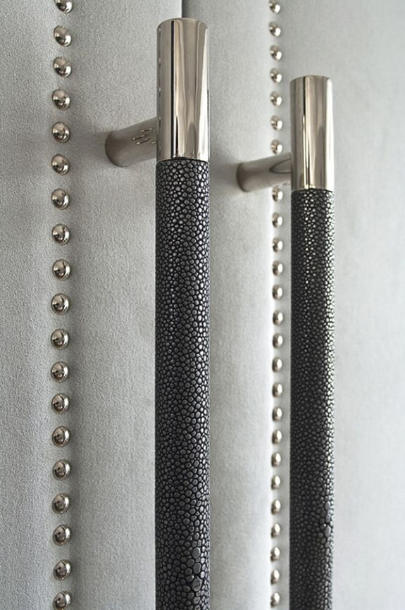 Shagreen leather handles on grey suede upholstered (and polished nickel studded) media doors at The Hyde Park Townhouse by Interior Designer Susan Knof of London-based designers, SHH Architects