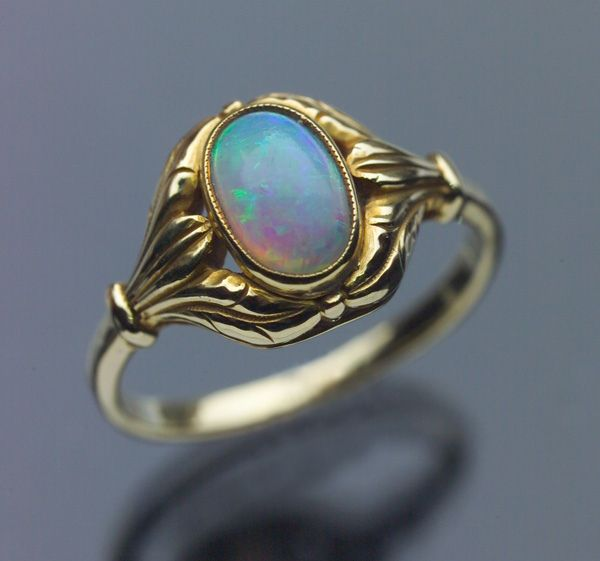 LIBERTY & CO Attrib. - Art Nouveau Ring. Gold and Opal. British, c.1900  Literature: cf. Liberty Jewellery sketch-book, p.71 variant (Ref: 7456)