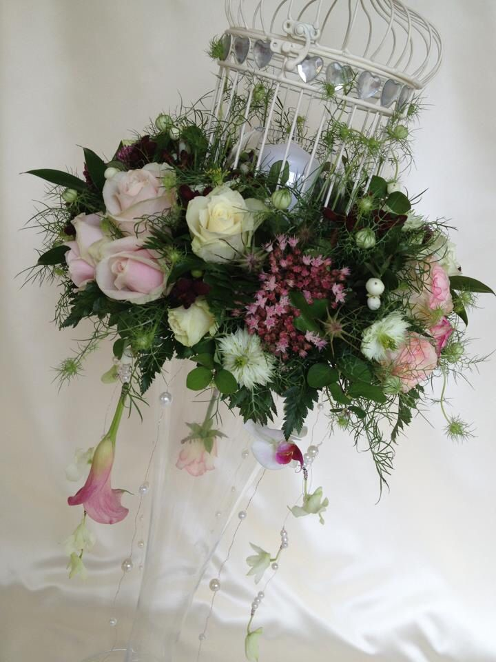 Birdcage arrangement on tall vase!! So beautifully different xxx Chanan's Floral Events