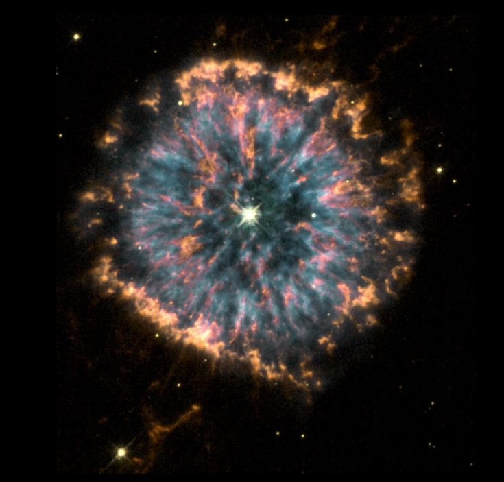 "NGC 6751 (nicknamed the ""Glowing Eye Nebula"") is a planetary nebula of some 0.8 light-year across (about 600 times the size of our Solar System), located roughly 6,500 light-years away from Earth in the northern constellation of Aquila."