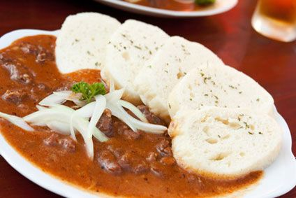 Traditonal Czech Goulash and Bread Dumplings ~ I'll have to try this... been dying for some good, spicy goulash since I got home from the Czech Republic. :)