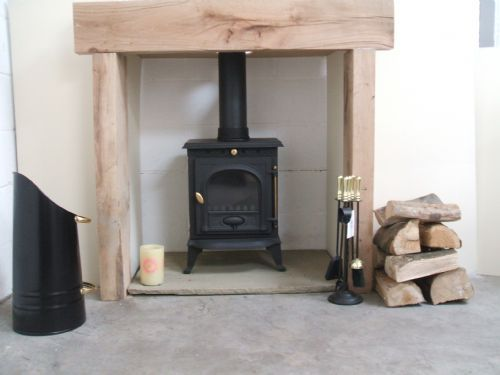 I like the rustic and cosy feel and way of supporting a chimney breast for a log burner