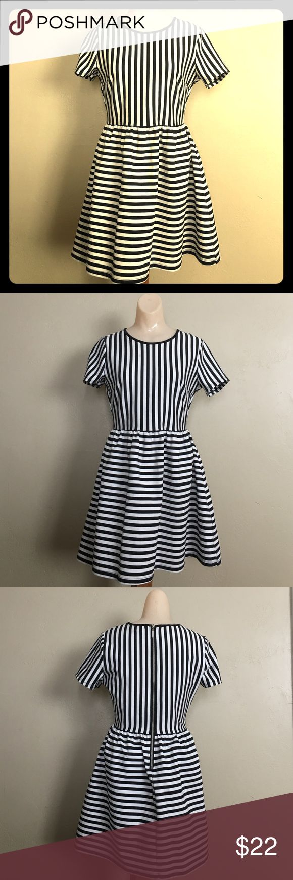 Forever21 black&white stripes mini dress size L Used but in a like new condition. No stains, or holes. We promise to ship as soon as we can. We offer bundle shipping. We store our products in a smoke free home. Forever 21 Dresses Mini