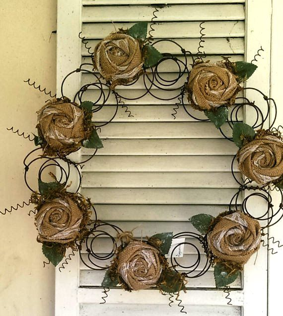 Re-purposed Bed spring Wreath Rolled Burlap Roses - pinned by pin4etsy.com