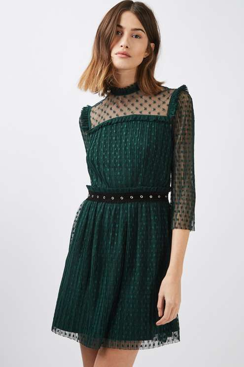 Sheer details and a skater silhouette make this pretty plisse dress a must-have. With mesh sleeves and shoulders, it comes with a high frill neck and contrasting studded waist trim for a perfect mix of romance and edge. #Topshop