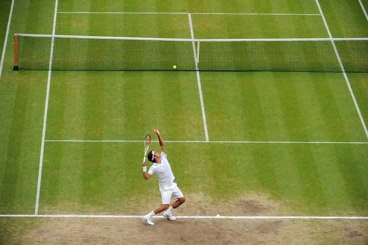 Roger Federer serves on Centre Court during his semi-final match against Novak Djokovic. - Tom Lovelock/AELTC