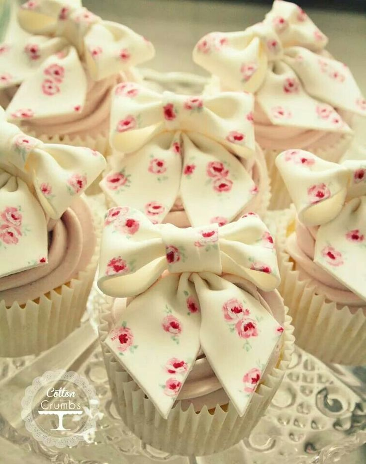 """Cupcakes with fondant bows... Cute idea for a bridal shower. Great """"girly"""" touch! #Watters #weddings http://www.pinterest.com/wattersdesigns/"""