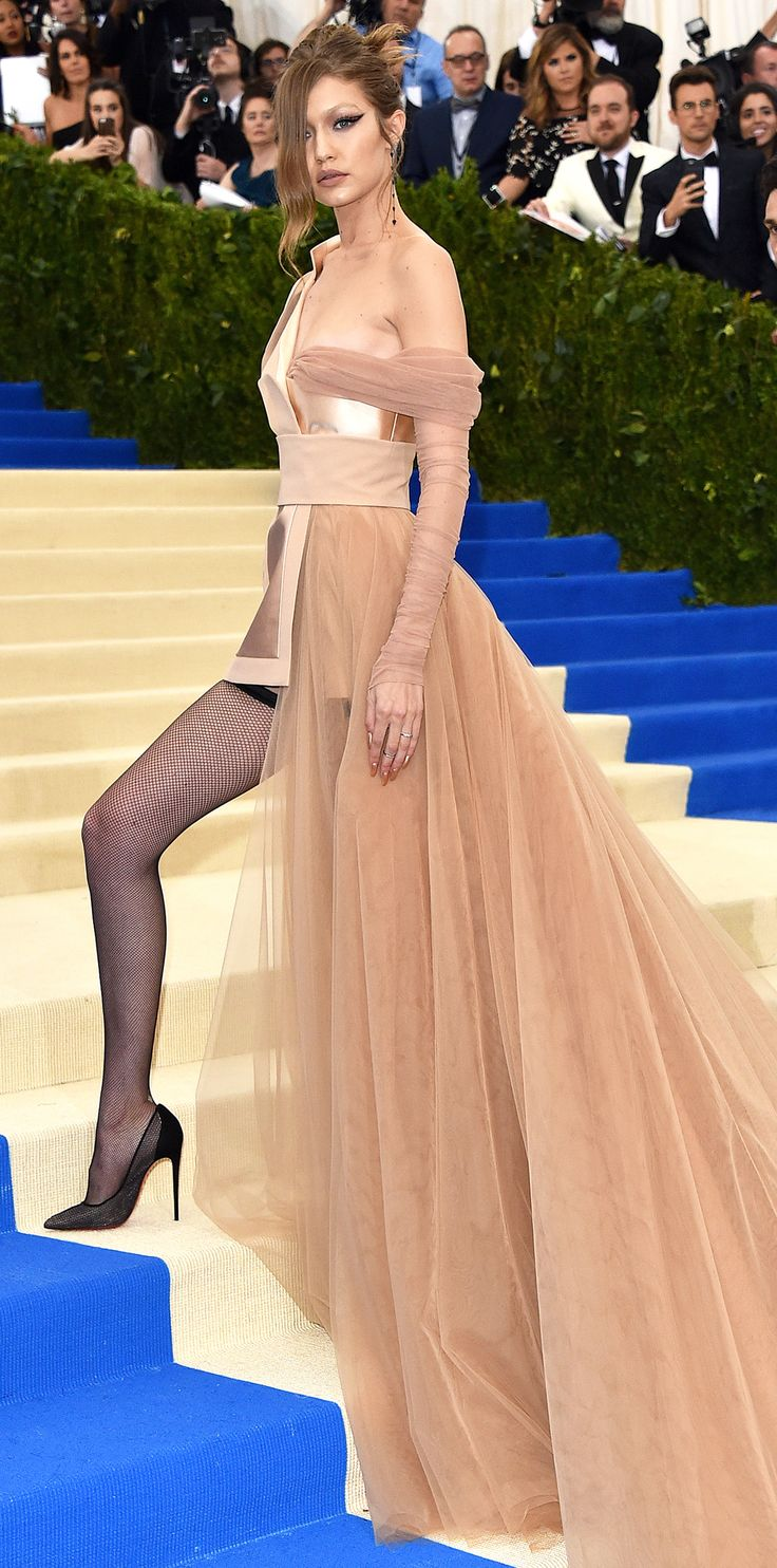 Met Gala 2017: Gigi Hadid's approach to Met Gala dressing = bring on the major va-va-voom. The supermodel wore a Tommy Hilfiger suit jacket-gown hybrid featuring luxe satin panels and crisp structuring, offset by rivers of tulle. Of course, Hadid didn't end there. She completed the look with thigh-high fishnet stocks and Christian Louboutin stilettos.