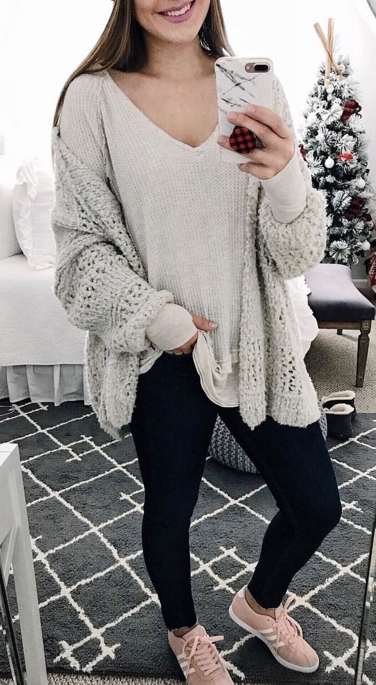 #winter #outfits women's gray knitted v-neck sweater and black denim jeans with pair of peach Adidas low-top sneakers. Click To Shop This Look.