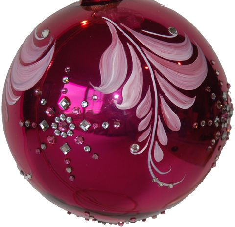 A delicately hand painted ornament to grace Christmas trees from one generation to the next. The burgundy gloss five inch diameter glass ornament is adorned with an hand painted flowing fern-like motif, quality round and square, pink and clear Swarovski crystals form large snowflakes around the surface and topped with a delicate white ribbon and sparkling embellishments. Designed to be a treasured heirloom for many years to come. http://mickeybaxterspade.com/christmas-ornaments/