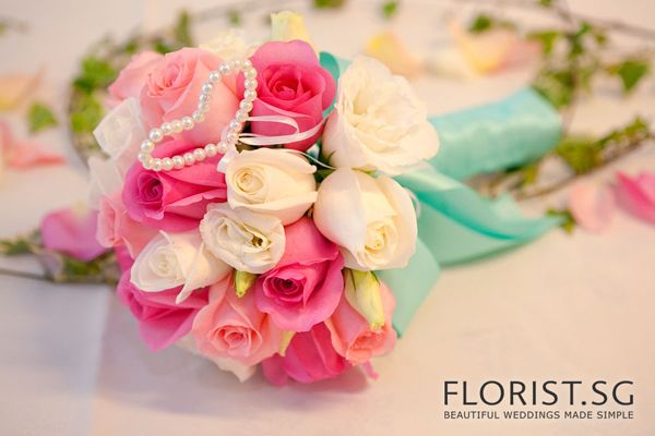 http://www.weddingdecor.sg/wp-content/uploads/2012/09/the-chevrons-solemnization-wedding-bouquet-tiffany-blue-ribbon.jpg