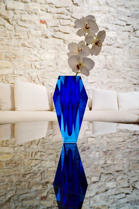 """Moser - A very successful modern vase """"Gema"""", which has 2000 as the year of origin, was complemented by new colour variations in 2008. The original cuts emphasise the colourful optic of this piece of art.  Mouth blown from ecologically friendly lead-free crystal, the vase was hand cut and hand polished in order to achieve a high gloss. Shop now https://boulesse.com/en/product/3538/Moser/Gema-Handcut-Underlay-Vase-aquamarine-blue"""