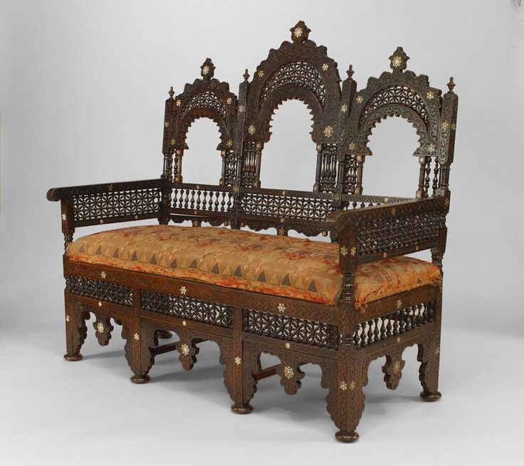 Middle Eastern Moorish walnut settee with spindle and ball design and pearl inlay with triple arch open design back with woven fabric seat (19th Cent.)