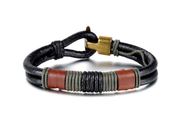 Eksklusivt skinnarmbånd med urfolk design. Ekte lær og bomullstråd. Godt gavetips for gutter og menn.