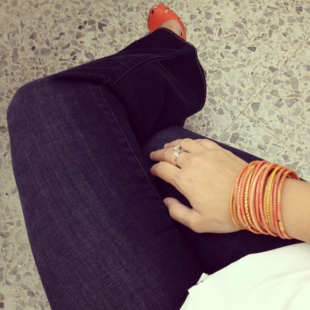 dark denim, white top, orange shoes and bracelets from Merci PARIS