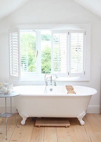 roll top bath in attic bathroom space. Give them space!