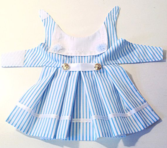 Sailor dog dress This sailor dog dress is made from cotton and is made in four different colour stripes, red, navy, pink or blue, very pretty little dress. I stock six sizes in this dress but will always make to your measurements if they are different from my stock sizes. The dress doesnt have a net petticoat but I can put one In it if you wanted just message me at preciouspup@live.com Or go to my website preciouspup.co.uk I can add a DRing and side release clips if needed. Sizing. Neck…