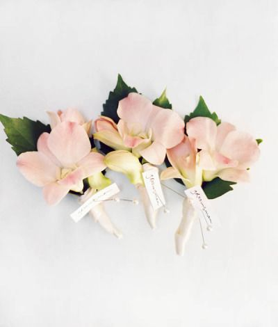 Orchid boutonnieres: http://www.stylemepretty.com/2013/01/10/big-island-wedding-from-beth-helmstetter-events-steve-steinhardt/ | Photography: Steve Steinhardt - http://stevesteinhardt.com/