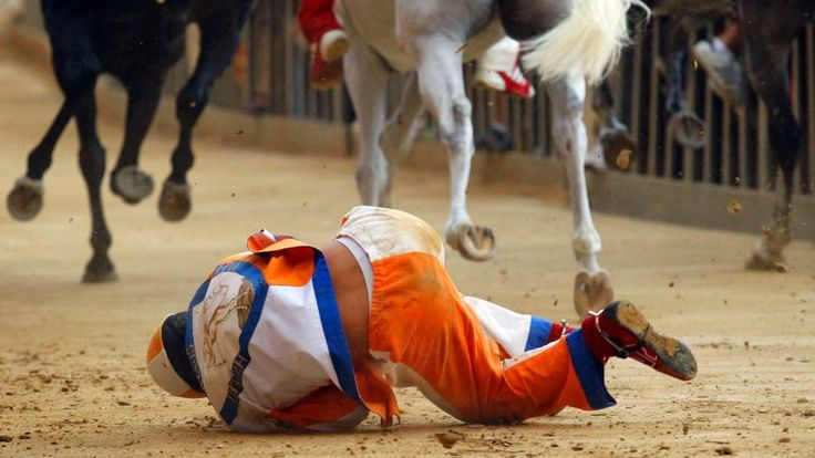 Bartoletti falls from his horse whilst racing for Leocorno during the Palio