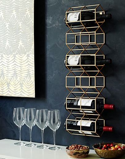 Whoever designed this geometric wine rack did something unthinkable- they made wine even better than it was before.