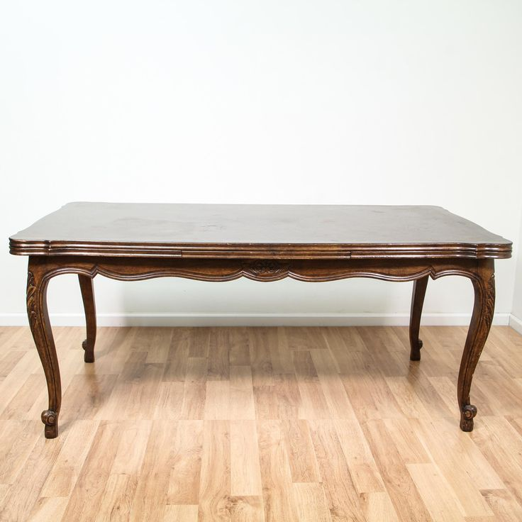 This Queen Anne inspired dining table is featured in a solid wood with a glossy dark wood finish. This dining table is in great condition with a carved curved trim, cabriole legs and a refectory fold out leaf table top. Perfect for casual and formal dining!  #victorian #tables #diningtable #sandiegovintage #vintagefurniture