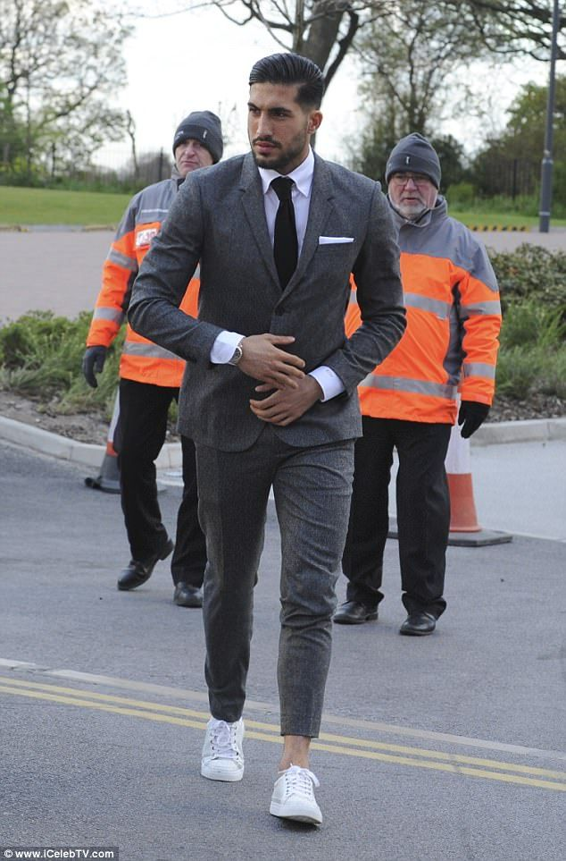 A suave looking Emre Can entered in a cut off suit worn with some white trainers...
