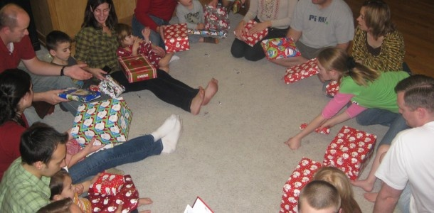 """Grinch Game {white elephant} gift exchange -- read """"How the Grinch Stole Christmas"""". Each time """"grinch"""" is read, pass to right. Each time """"who"""" is read, pass to the left. Fun!!"""