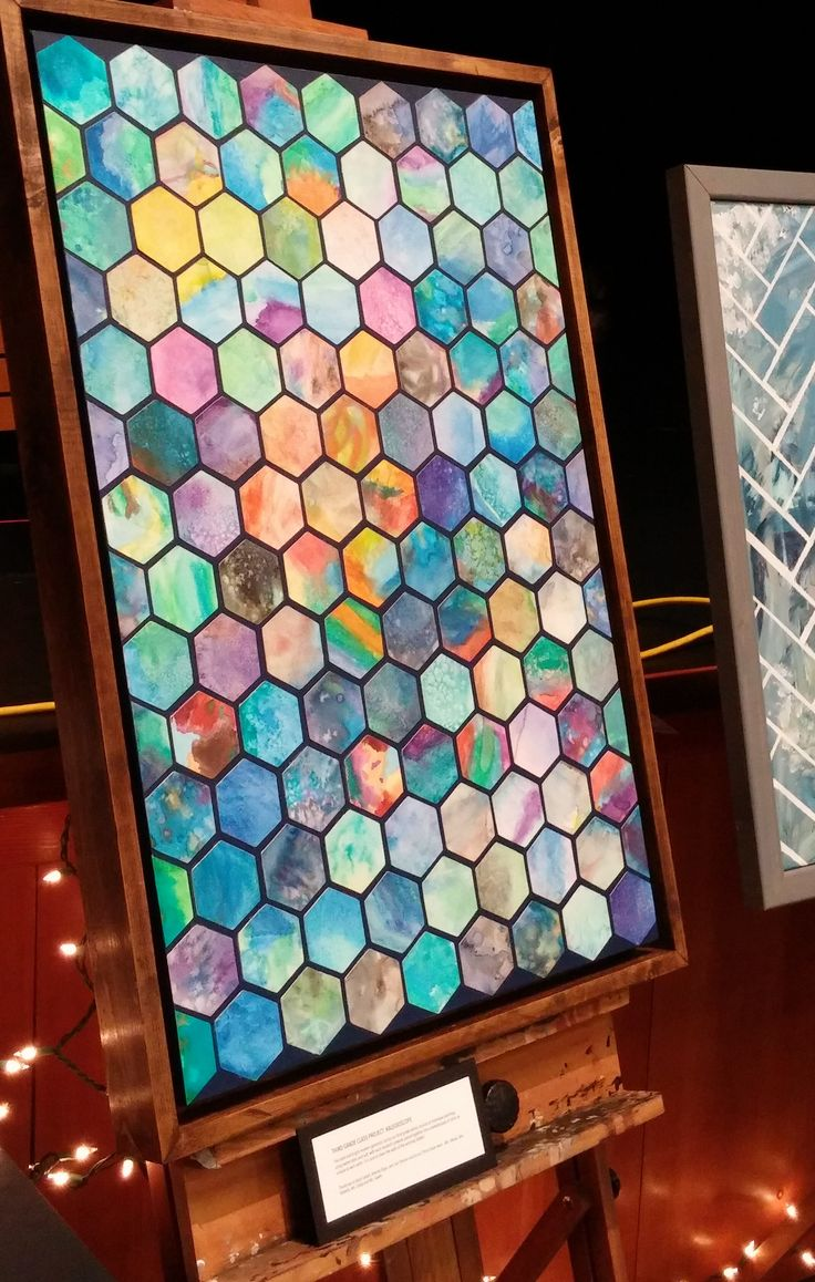 """3rd grade project, Kenmore Elementary 2016. Kids painted watercolors with salt. 3"""" Hexagons cut with cricut, then modge-podged onto blue-painted canvas. Finished with a hand made floating frame."""