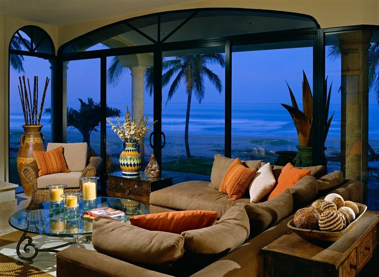 Tropical Living Room with Sectional sofa, Ocean view, Arched window, Backyard X-Scapes Bamboo Poles Bundle, Concrete floors