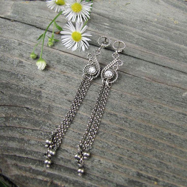 Long, filigree earrings with zircons. #bridaljewelry #earrings #silverjewellery