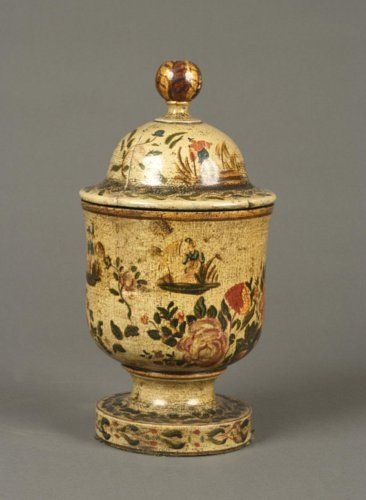 An early 1800s tole painted urn