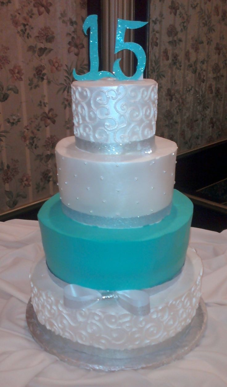"""Shimmery Siver and Turquoise - 6"""", 9"""", 12"""" 14"""" rounds all decorated with Pastry Pride. Airbrushed with pearl shimmer. Siver ribbon is fabric and numbers re gumpaste with disco dust. Thanks for looking!"""