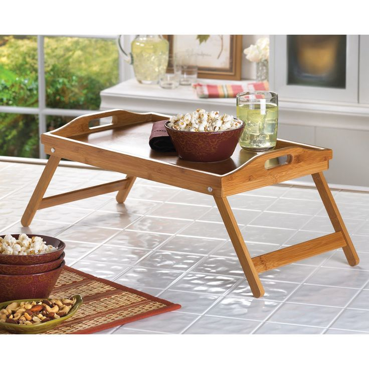 Bamboo breakfast in bed tray and the legs fold under for a traditional serving tray.