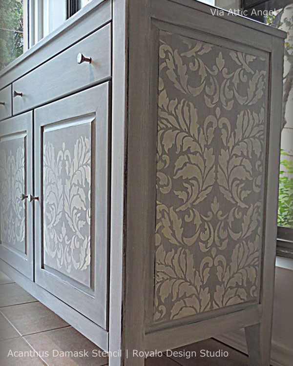 Use a large damask #stencil to freshen up plain cabinet doors.